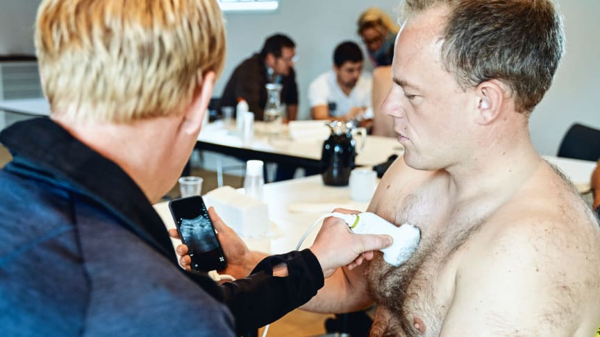 Paramedics are being trained to perform blood tests and ultrasound-scan lungs with mobile equipment, enabling them to diagnose and treat chronic disease patients in their homes. Photo: Falck
