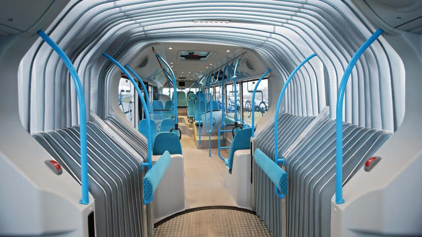 transparent ledsektion mellem den forreste og bageste del af bussen