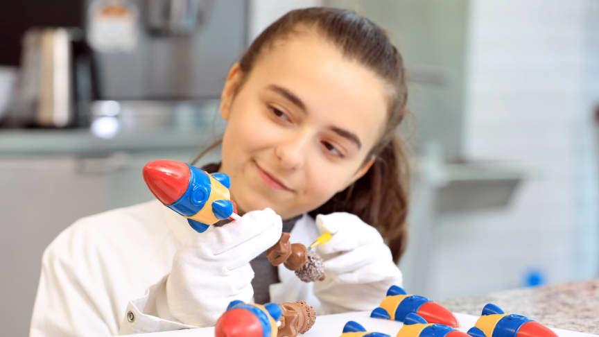 Catherine Young, 16, from Clackmannashire in Scotland with prototypes of her winning entry in the competition to engineer the chocolate bar of the future, 'Rocket Fuel'