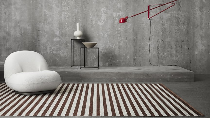 Narrow Stripe Icon, a woven rug in the finest wool with exciting color combinations and a graphic pattern.