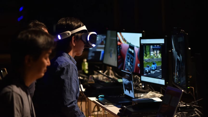 Participants experiencing Virtual Reality technology at SIGGRAPH Asia 2018