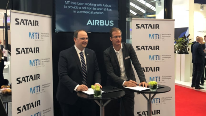 George Palikaras, Founder and CEO, Metamaterial Technologies Inc. (left) and Bart Reijnen, CEO, Satair, sign agreement at MRO Europe 2018.