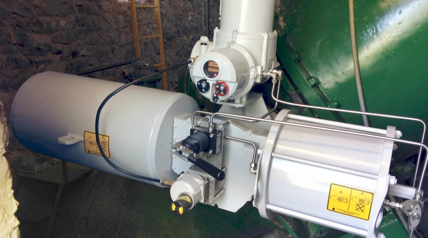 Rotork Skilmatic actuator on site where it operates a critical butterfly valve on a pipeline feeding the power plant's turbine.