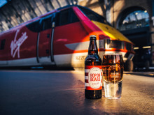 Virgin Trains creates a glass that is always half full to celebrate the launch of new 'Hop on Board' ale