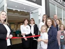 ​New vision and home for Monmouth opticians, as eye cancer youngster opens Vision Express doors