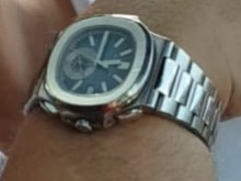 Appeal to trace suspects and stolen watch