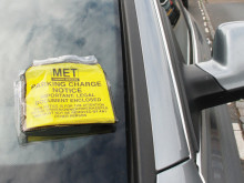 Photo of a parking fine notice on a car windscreen