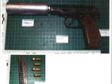 Recovered firearm and silencer
