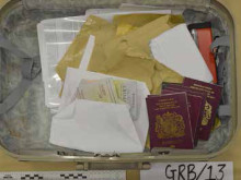 Suitcase containing passports found at an address in East Ham.