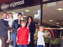 ​Eye cancer youngster Harry helps officially open doors to Vision Express Hungerford