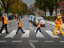 The road safety minister, two Cub Scouts and road safety mascot Horace recreate the famous Beatles album cover at the zebra crossing on Abbey Road