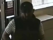 CCTV still of a man sought in connection with robbery