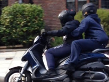 CCTV still of moped