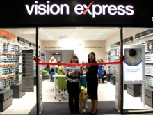 Irvine resident officially opens doors to new local Vision Express store.