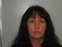 School business manager and her partner jailed