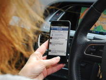 Illegal handheld mobile phone use at the wheel still rife