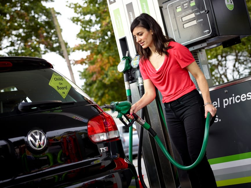Motorist filling up with unleaded