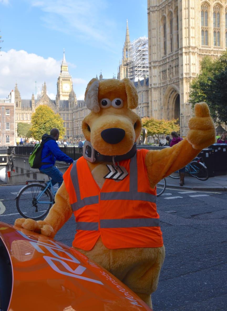 Horace waving with RAC patrol van and Big Ben