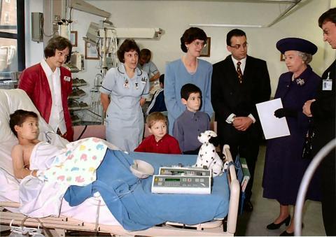 Nick Plotnek and his family, including son Robert, meet the Queen when she opened Birmingham Children's Hospital in 1998