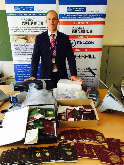 Detective Chief Inspector Andy Gould with some of the documents recovered by Amberhill
