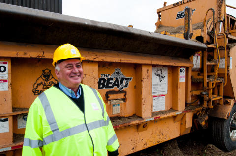 Recycling assistant Donnie Mclean next to the 'Beast' shredding machine.