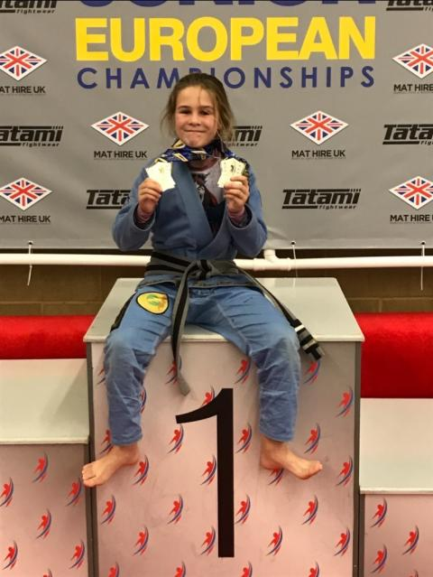 Lois Marsh, 10, of Colchester shows off her BJJ European Championship medals