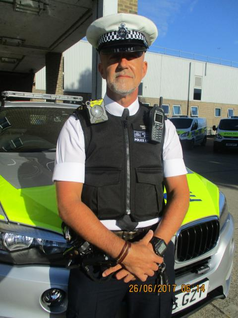 PC Dave Derby with camera.