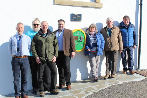 Life-saving defibrillator installed at Burghead harbour office