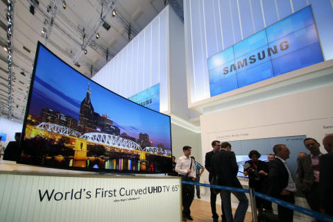 Samsung Electronics unveiled the world's first Curved UHD TV