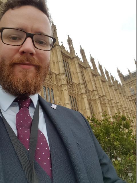Euan Macfarlane outside The Houses of Parliament