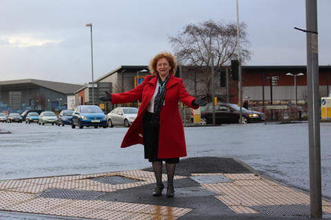 ROAD IMPROVEMENTS: Councillor Cecile Biant at the Molesworth Street/John Street junction with Smith Street and Entwistle Road which has been resurfaced