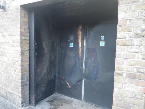 The fire damaged emergency exit door