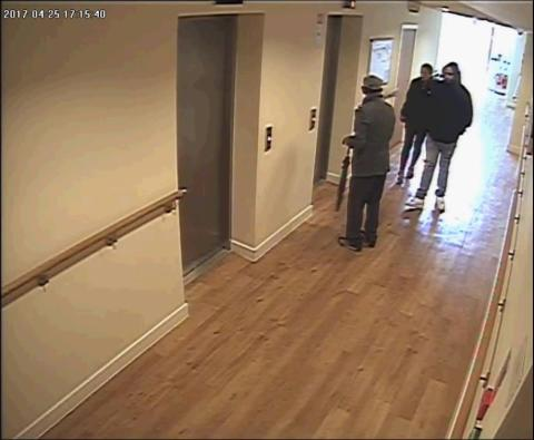 Rogers and Singh following the victim as he approached a lift at the block of flats