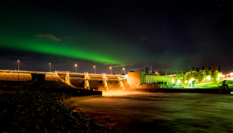 Hydro power station with Northern Lights