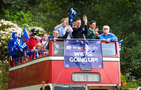 Town celebrates football promotion in style