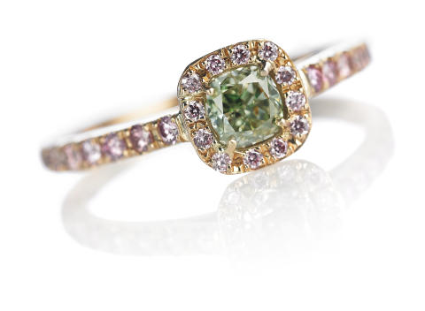 Green and pink diamond ring set with a natural fancy intense green diamond and  natural pink Argyle diamonds.