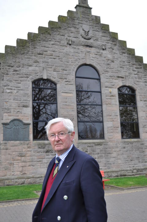 Grenville Johnston LL of Moray outside the former Drill Hall in Elgin