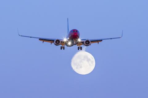 Norwegian 737-800 aircraft moon image