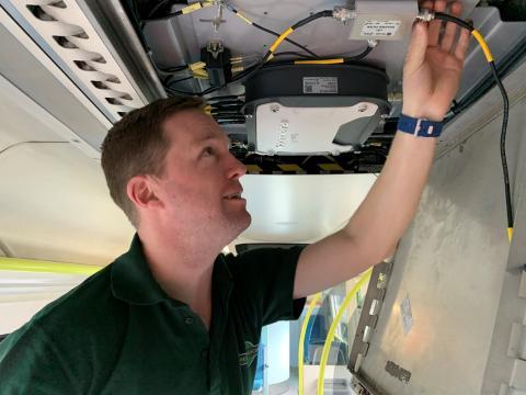 GTR Wireless engineer Robin Hayman fitting wi-fi 3