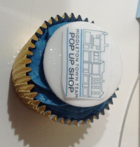 Sweet smell of success: the shop's logo on a celebratory cupcake