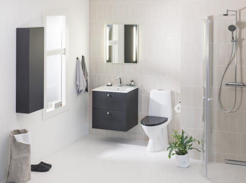 IDO Elegant -pesuallas, -alakaappi ja -puolikorkea kaappi, IDO Rimfree -wc-istuin, IDO Reflect -seinäpeili ja IDO Showerscreen