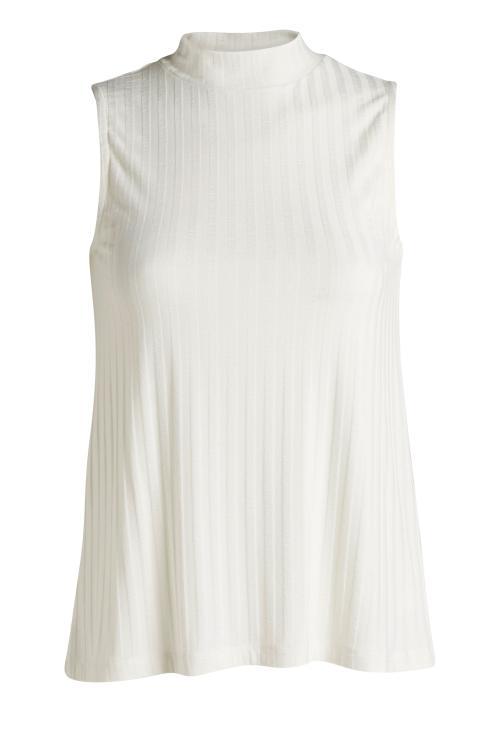White sleeveless turtelneck