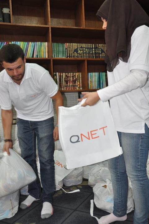 QNET's Independent Representatives distribute bags of food to the underprivileged in Warak, Cairo