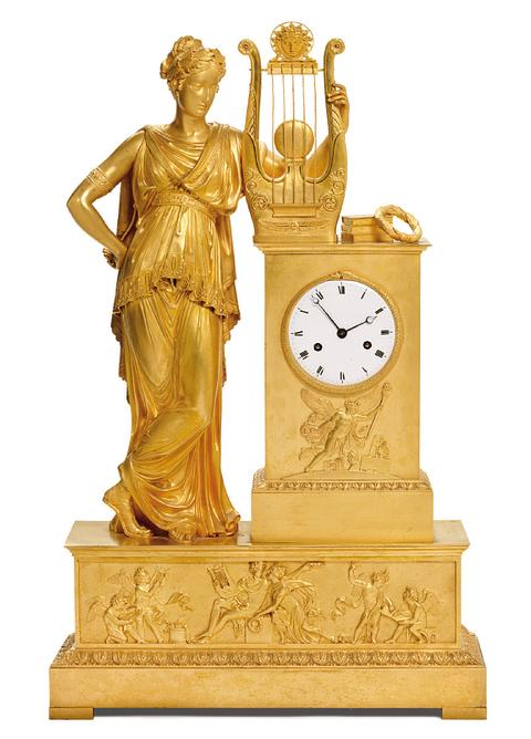 A large French Empire gilt bronze mantel clock
