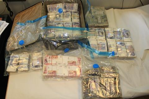 £1.5m cash seized and 13 arrested on suspicion of money laundering