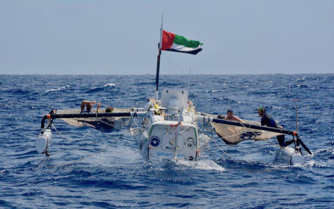 Hi-res image - Inmarsat - The crew of Row4Ocean attach a tow line to support vessel Supertramp for the final 750nm