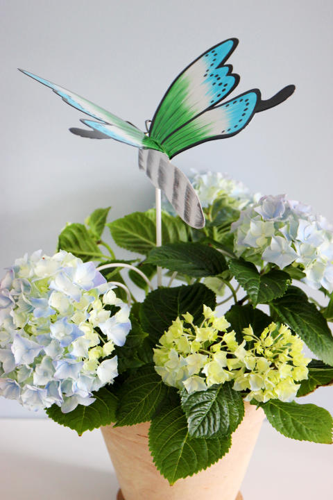 Blomsterpinnar av metall