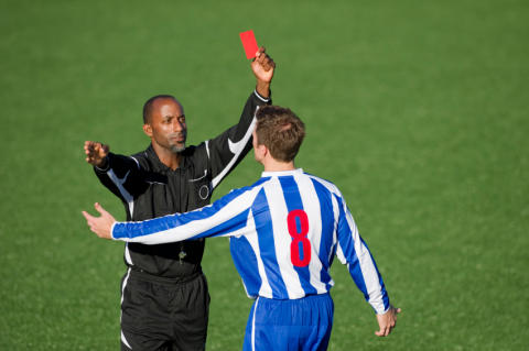 Football referees cope by thinking they are better than other refs