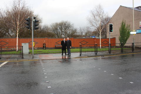 ROAD IMPROVEMENTS: Councillor Raymond Dutton and Councillor Liam O'Rourke at the junction of Bridge Street and Pilsworth Road which has been resurfaced