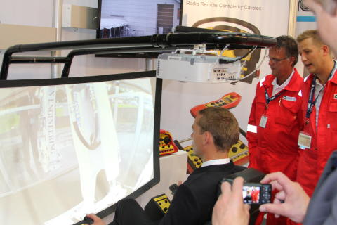 Norway's Minister of Petroleum and Energy, Ola Borten Moe, operates an excavator using a Cavotec radio remote control video link system at ONS 2012